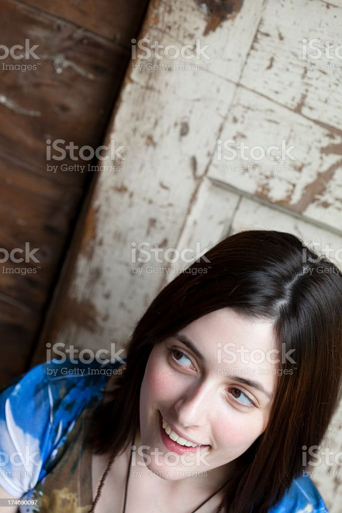 Girl Against a Old Door royalty-free stock photo