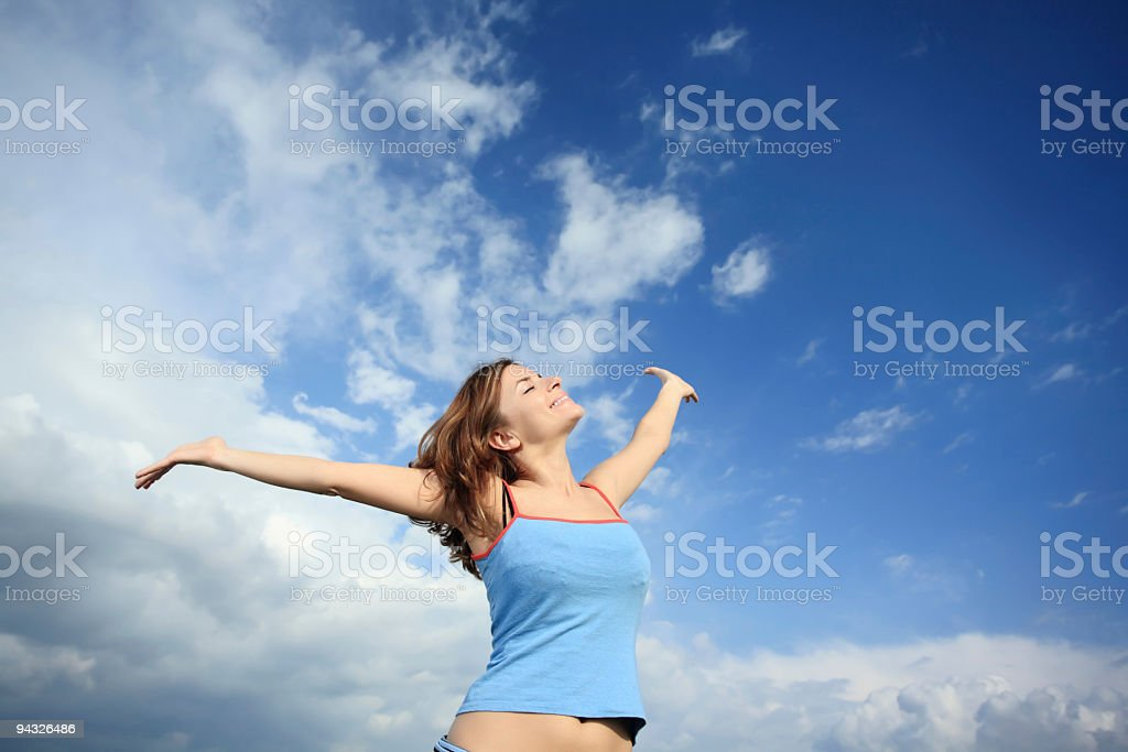 Girl against the sky. royalty-free stock photo