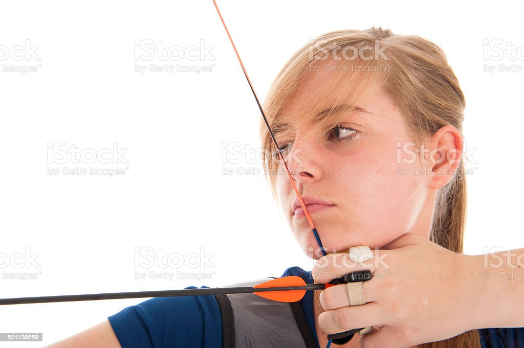Girl aiming with bow and arrow in closeup stock photo