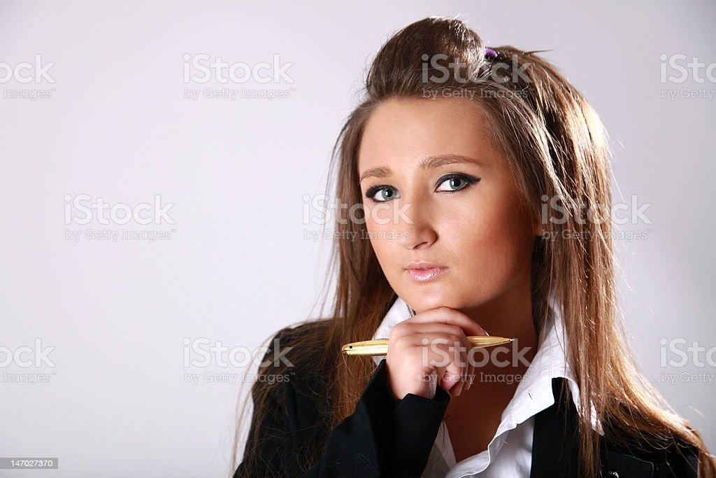 Girl aith a pen royalty-free stock photo