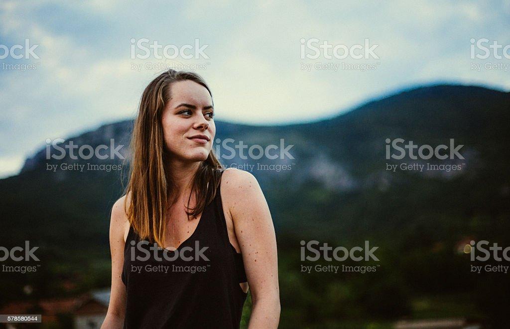Girl among wonderful mountin scenery stock photo