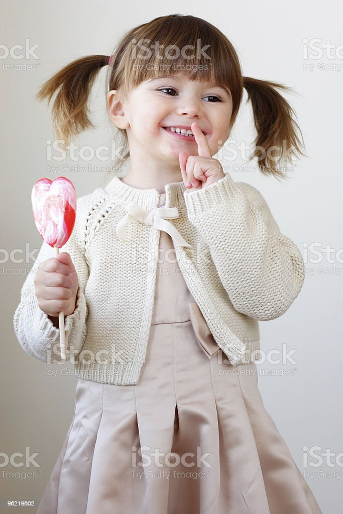 Girl and a lollipop royalty-free stock photo