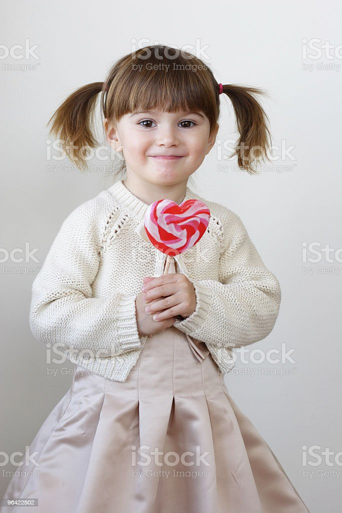 Girl and a lollipop stock photo