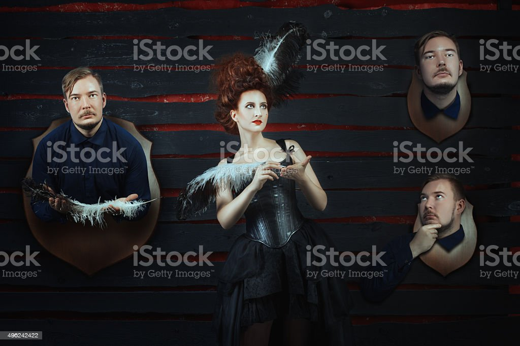 Girl and a man's head on the wall. stock photo