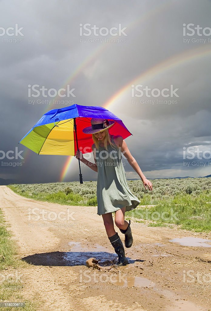 Girl and a rainbow royalty-free stock photo