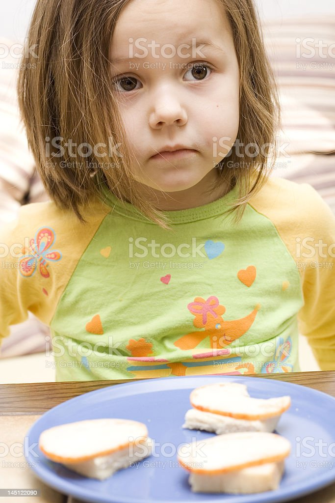 Girl and a sandwich royalty-free stock photo