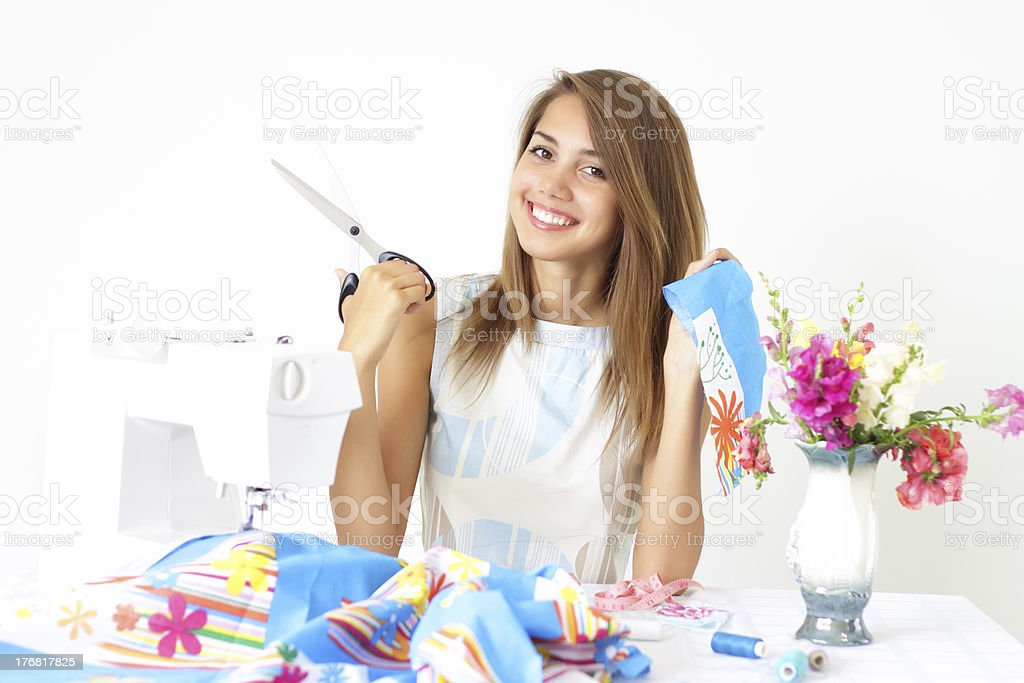 Girl and a sewing machine royalty-free stock photo