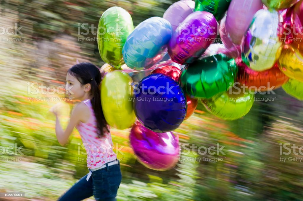 Girl and Balloons royalty-free stock photo