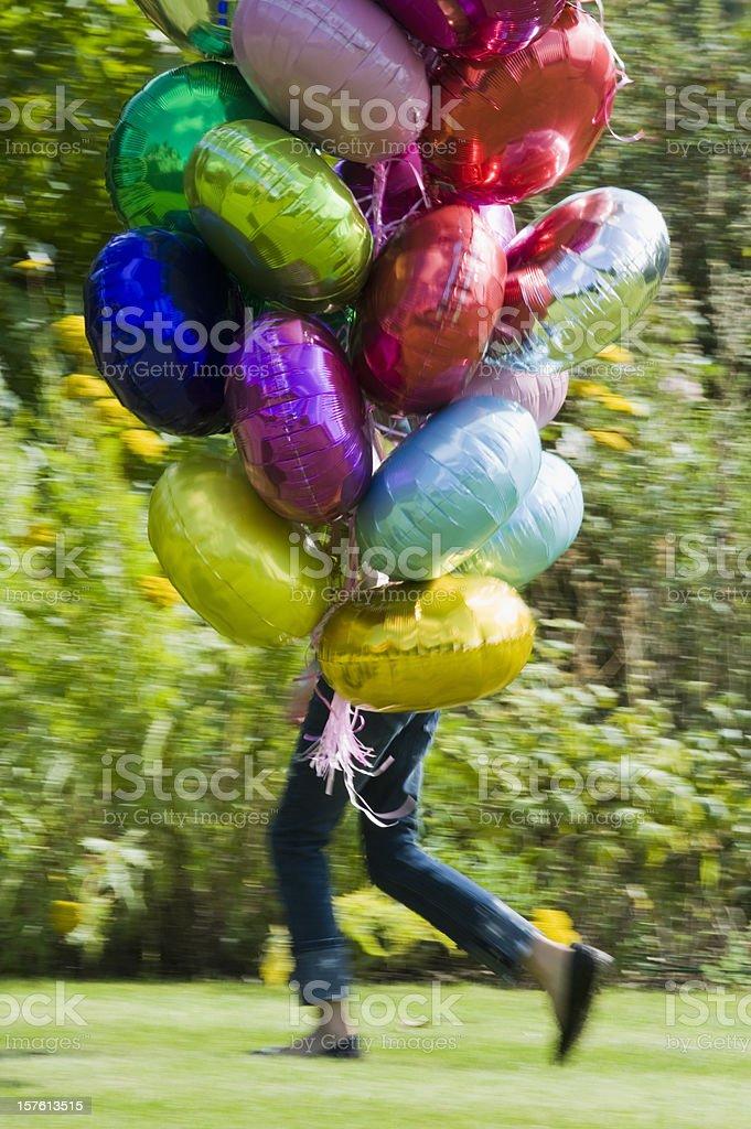 Girl and Balloons stock photo
