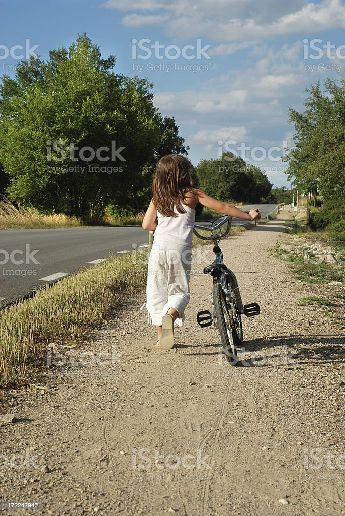 Girl and bike royalty-free stock photo