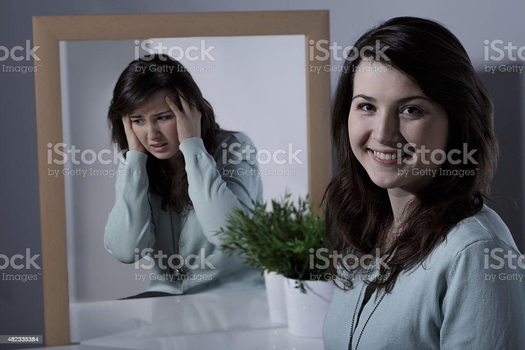 Girl and bipolar disorder stock photo