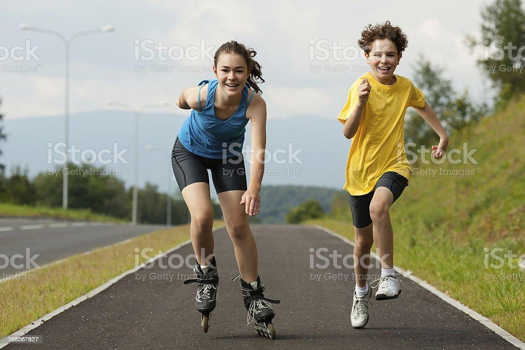 Girl and boy exercising outdoor stock photo
