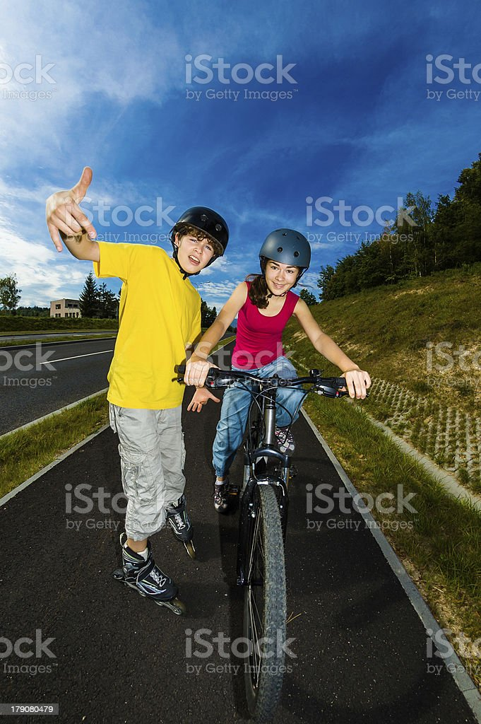 Girl and boy exercising outdoor royalty-free stock photo