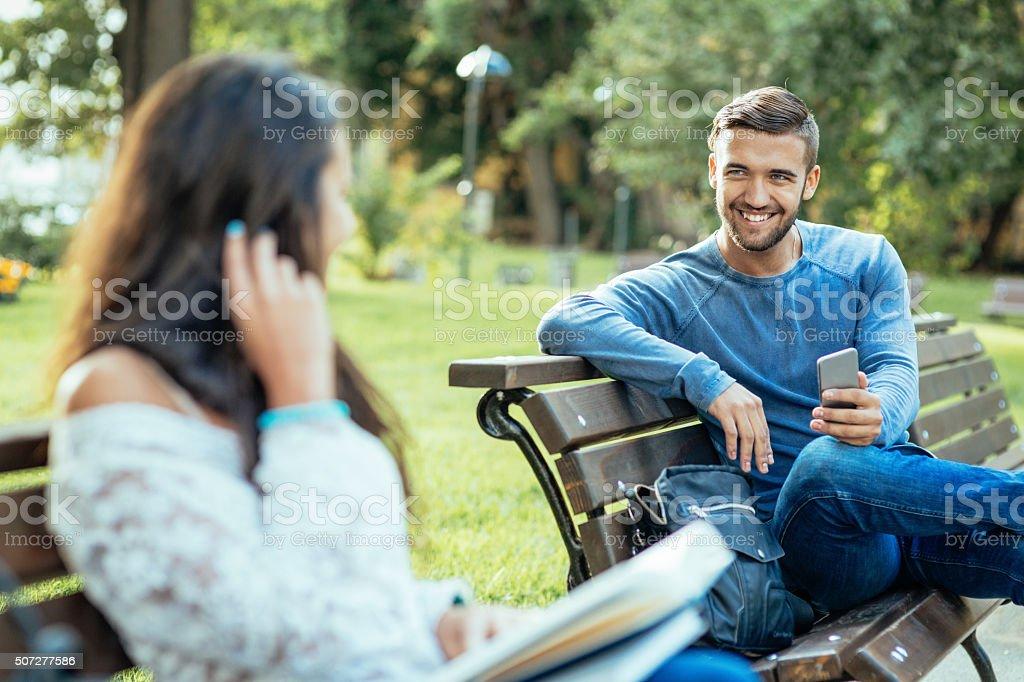 Girl and boy flirting stock photo