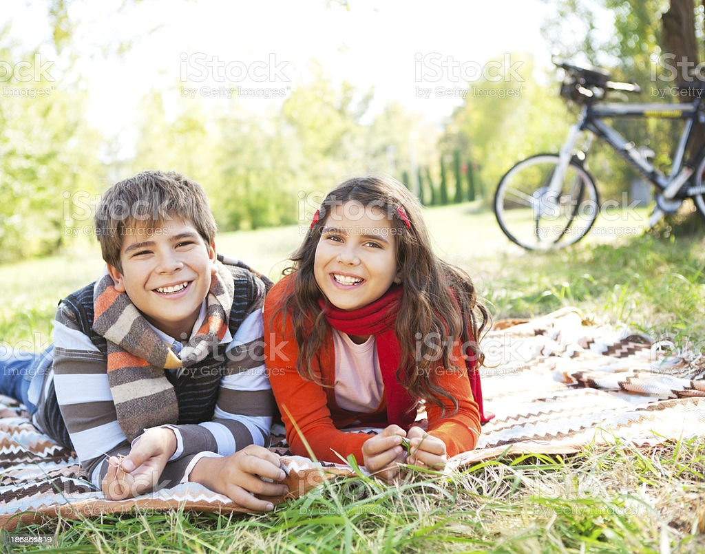 Girl and boy in autumn park. royalty-free stock photo