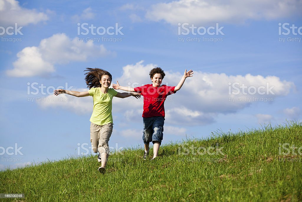 Girl and boy jumping outdoor royalty-free stock photo