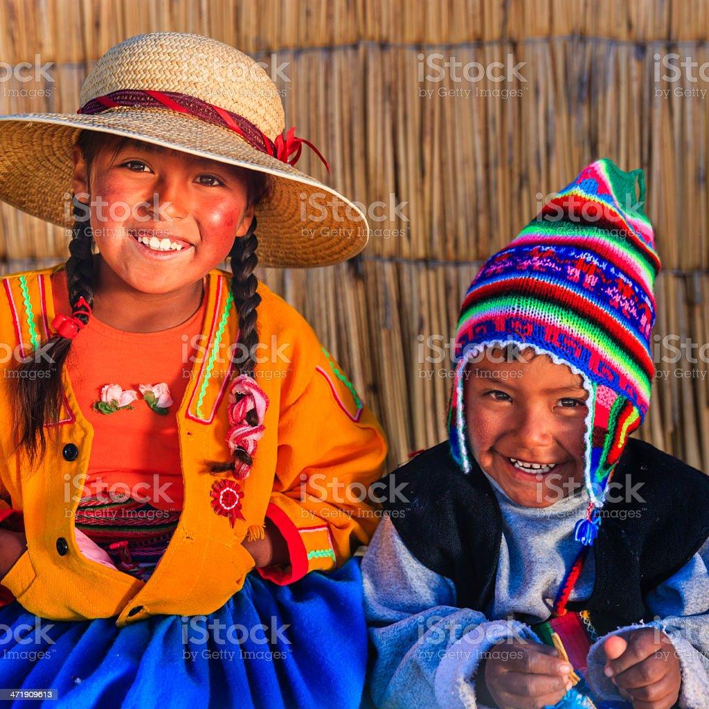 Girl and boy on Uros floating island, Lake Tititcaca, Peru stock photo