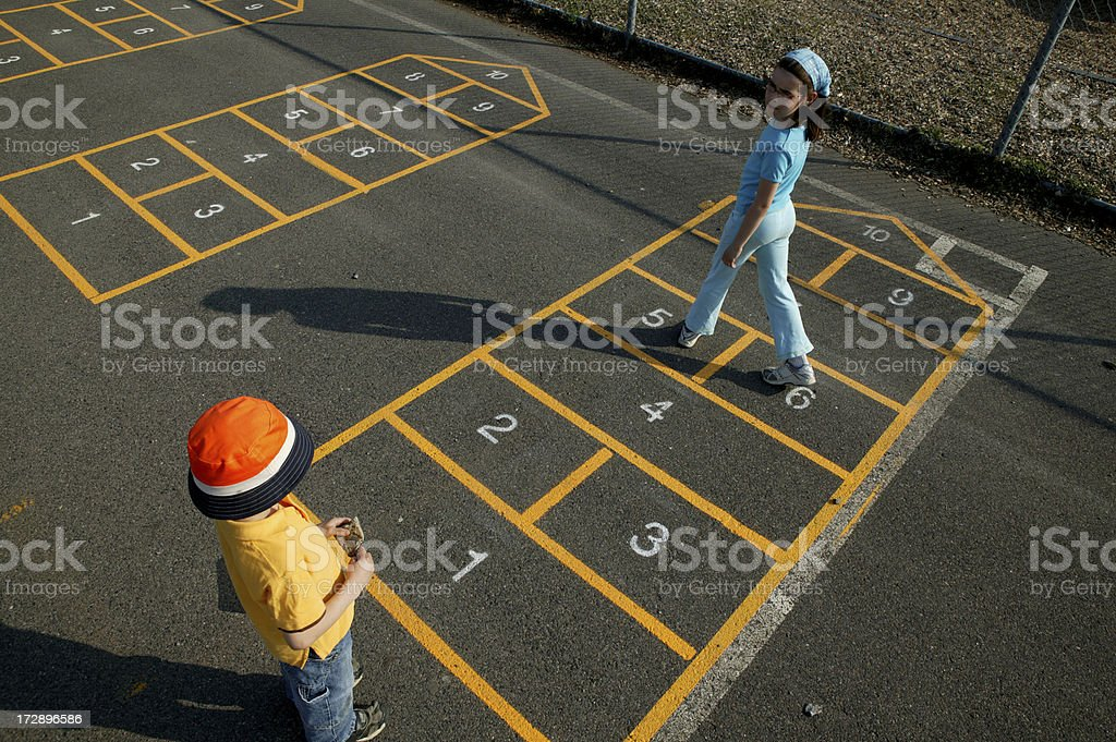 girl and boy playing hopscoth royalty-free stock photo