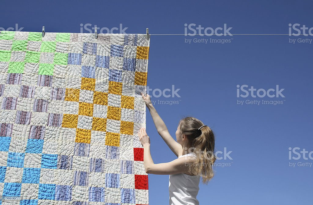 Girl and bright laundry royalty-free stock photo