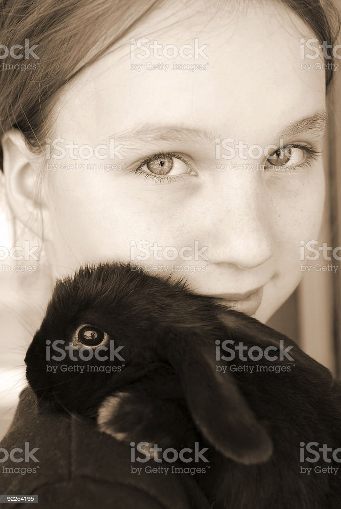 Girl and bunny stock photo