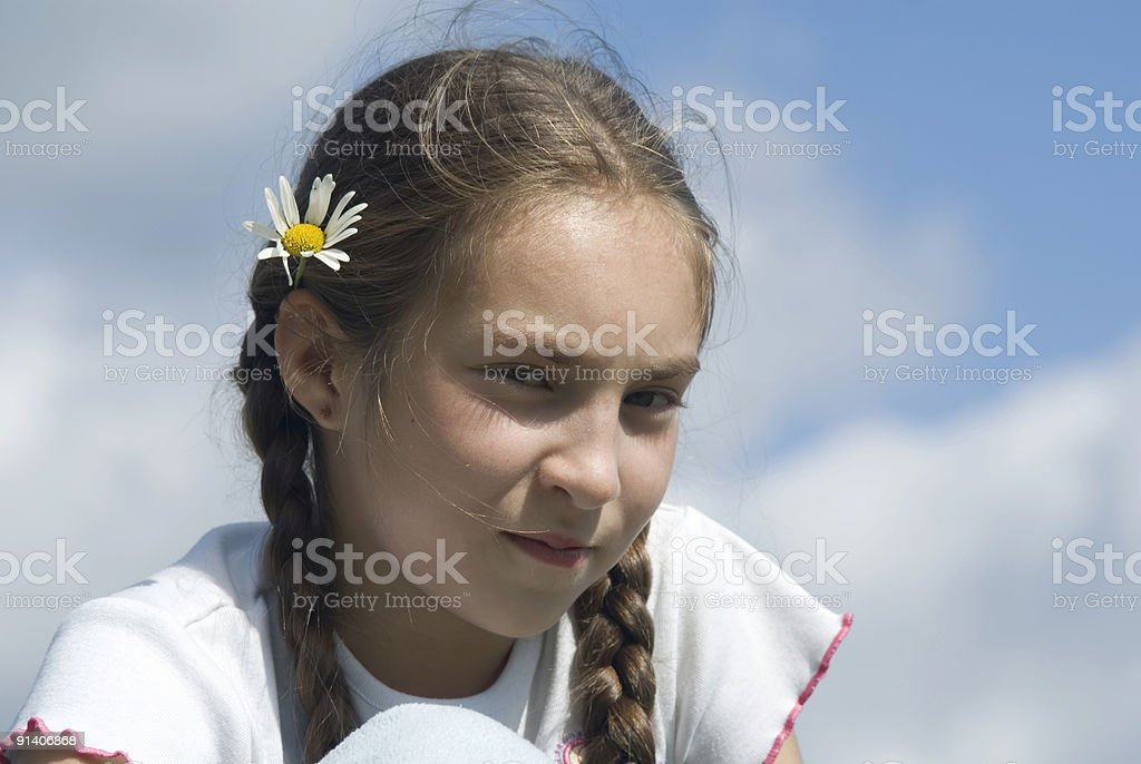 Girl and camomile III royalty-free stock photo