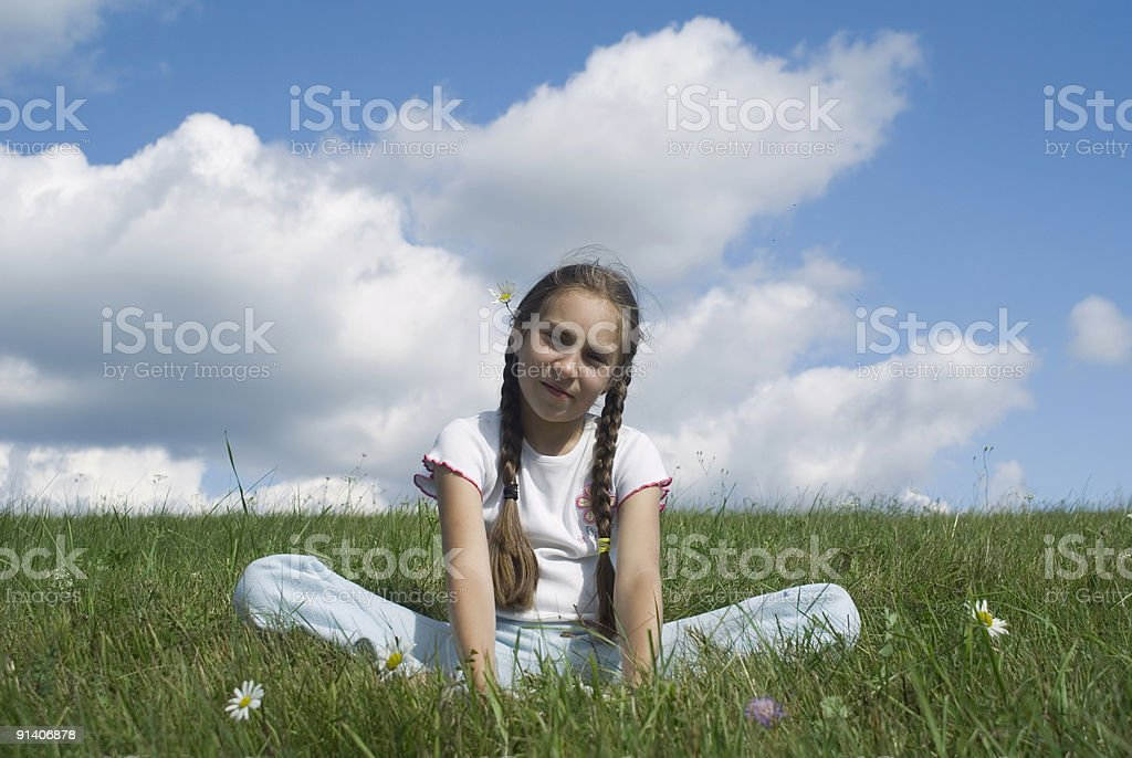 Girl and camomile V royalty-free stock photo