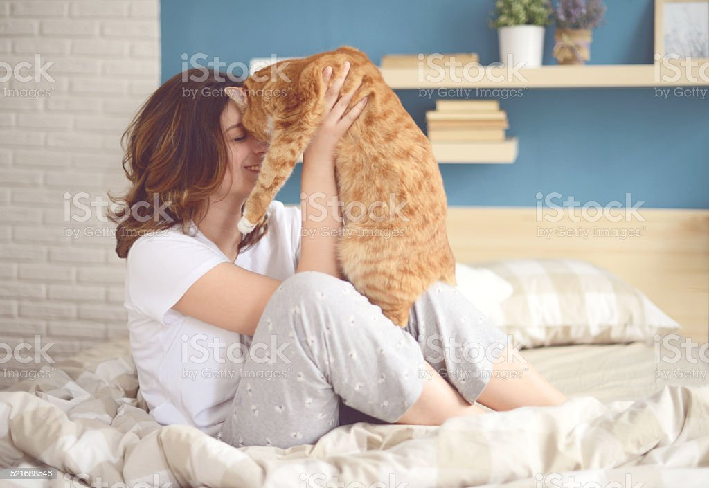 girl and cat stock photo