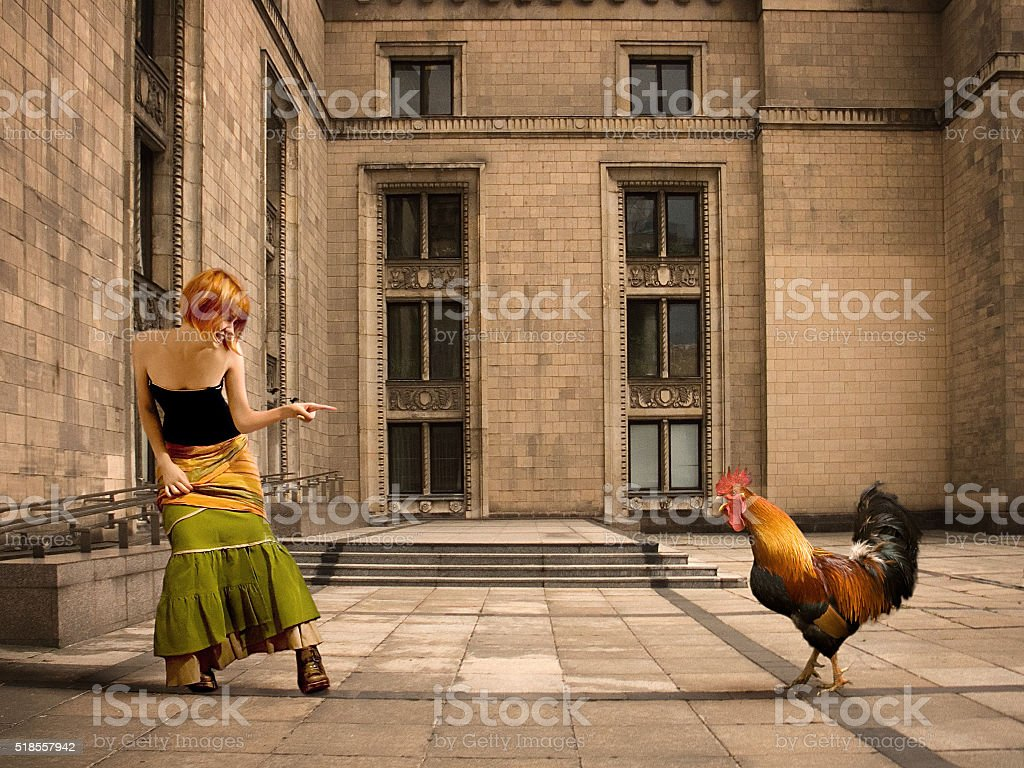 Girl and Cock stock photo