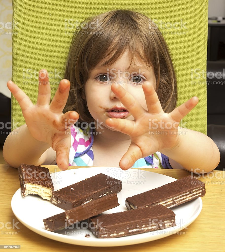 Girl and cookies stock photo