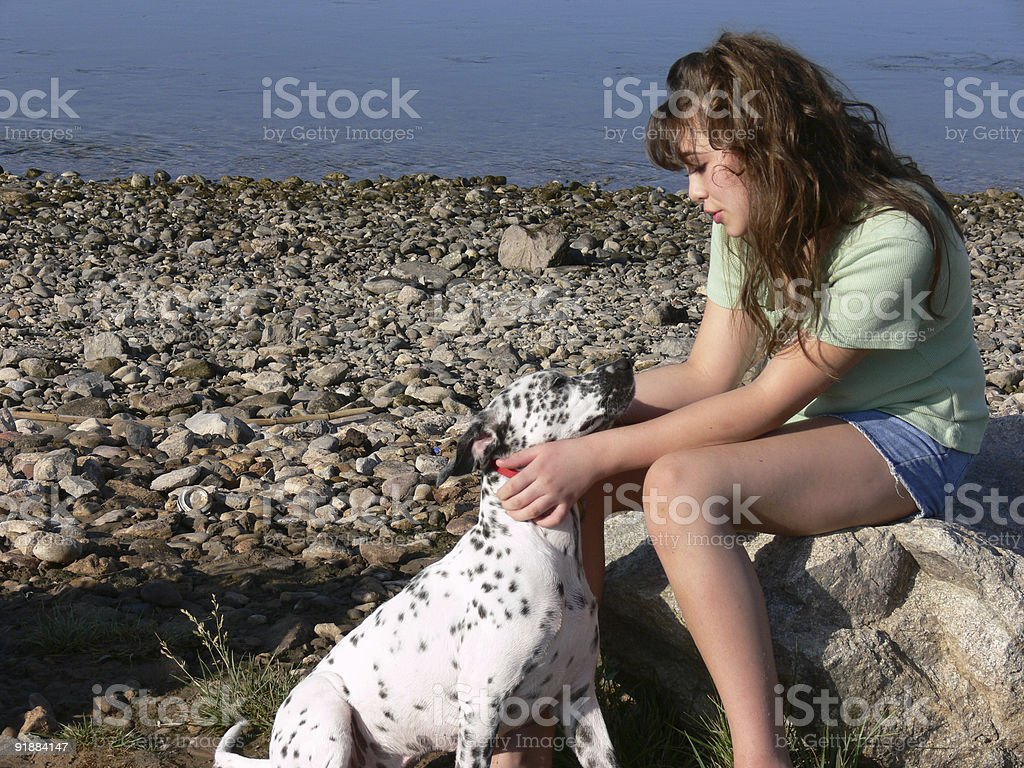 Girl and Dog at the River stock photo