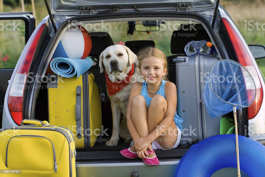 Girl and dog ready for summer vacation stock photo