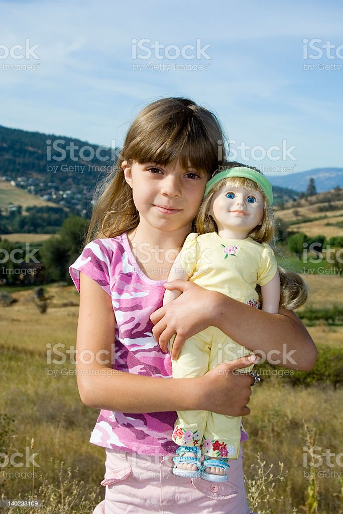 Girl and doll royalty-free stock photo