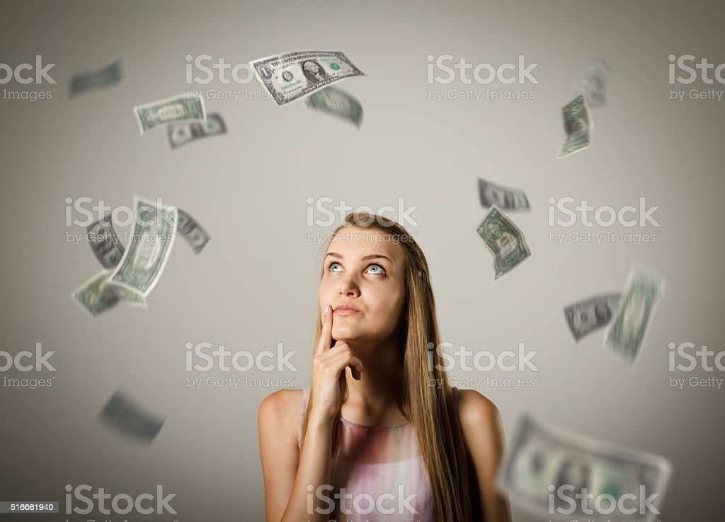 Girl and dollars. stock photo