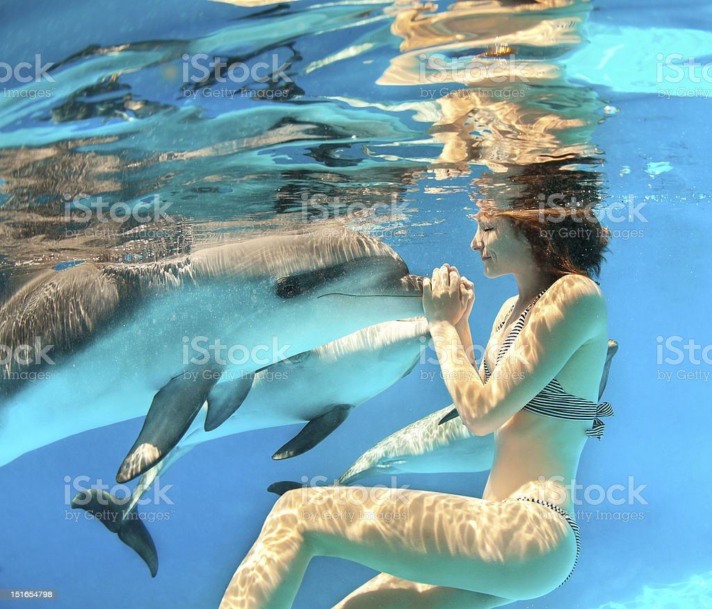 Girl and dolphin stock photo