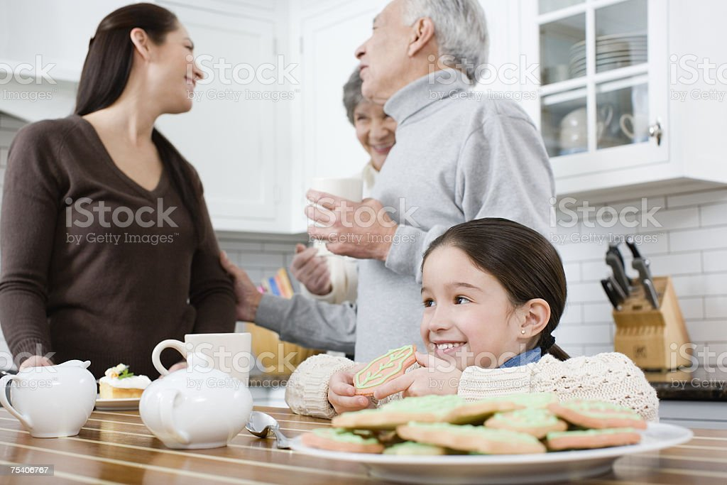 Girl and family in kitchen stock photo