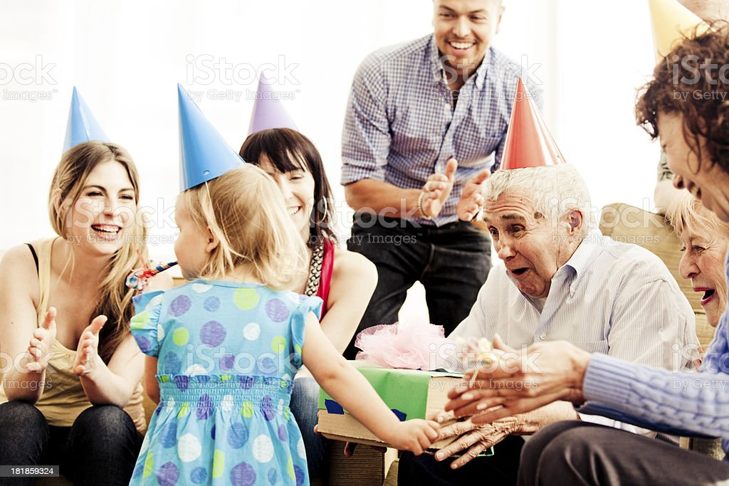 A girl and family reunited in grandfather's birthday party royalty-free stock photo