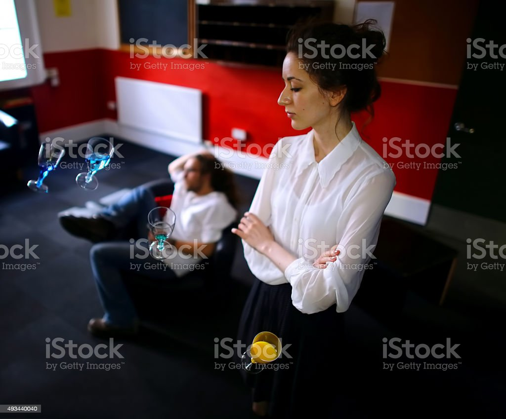 Girl and floating wine glasses stock photo