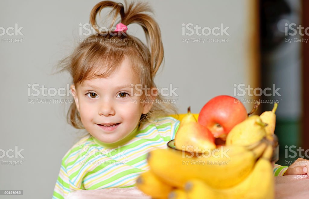Girl and fruit royalty-free stock photo