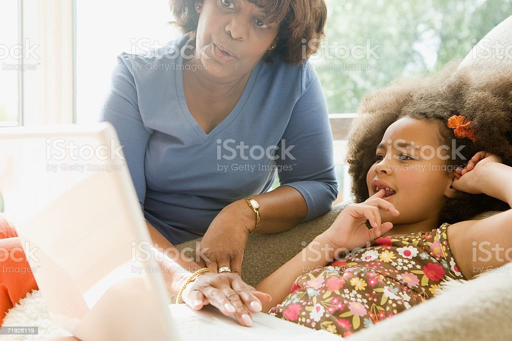 Girl and grandmother with laptop royalty-free stock photo