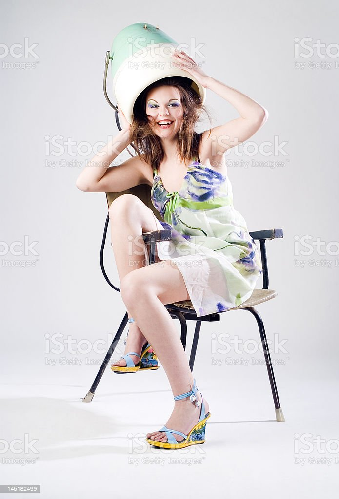 Girl and Hair Dryer royalty-free stock photo