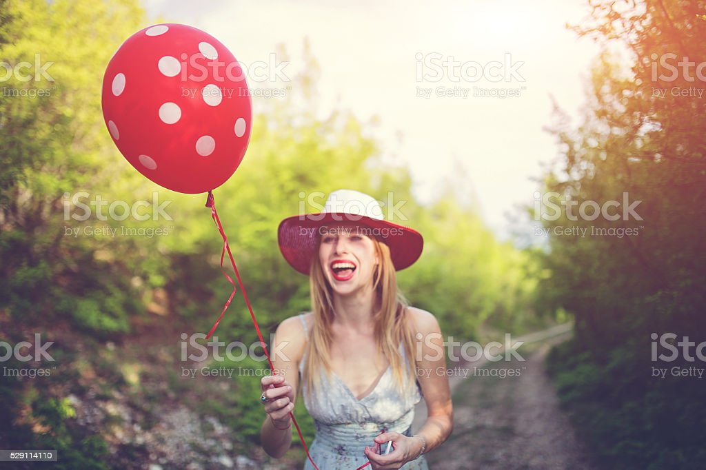 Girl and her balloon stock photo
