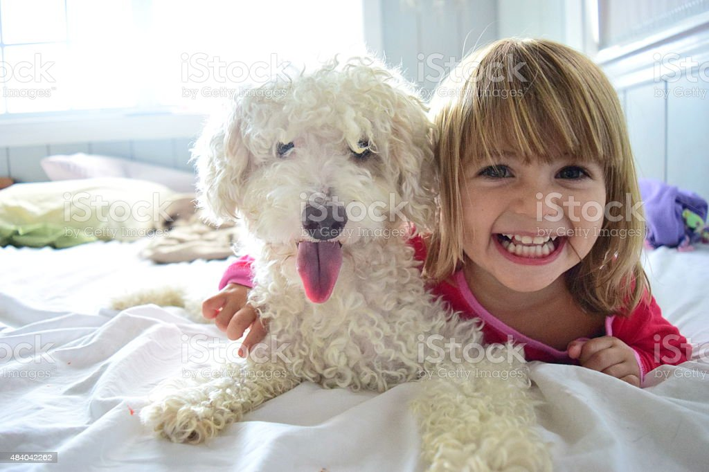 Girl and her best friend stock photo
