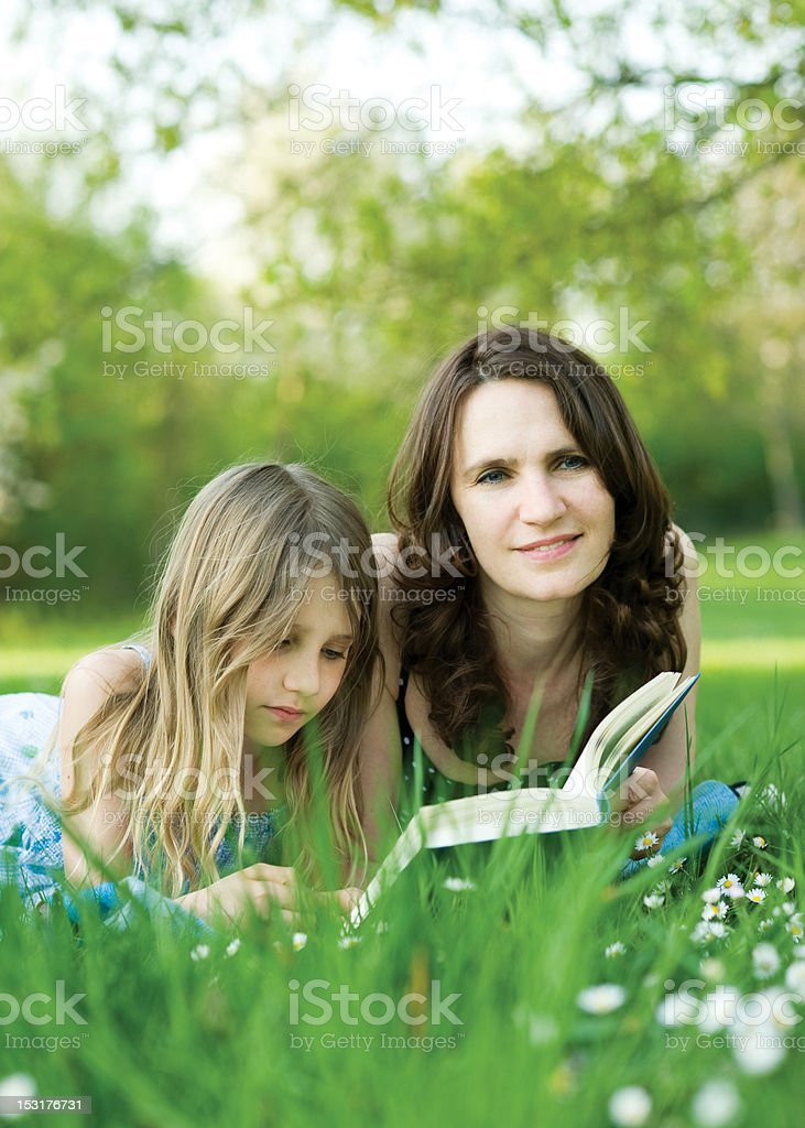Girl and her mommy royalty-free stock photo
