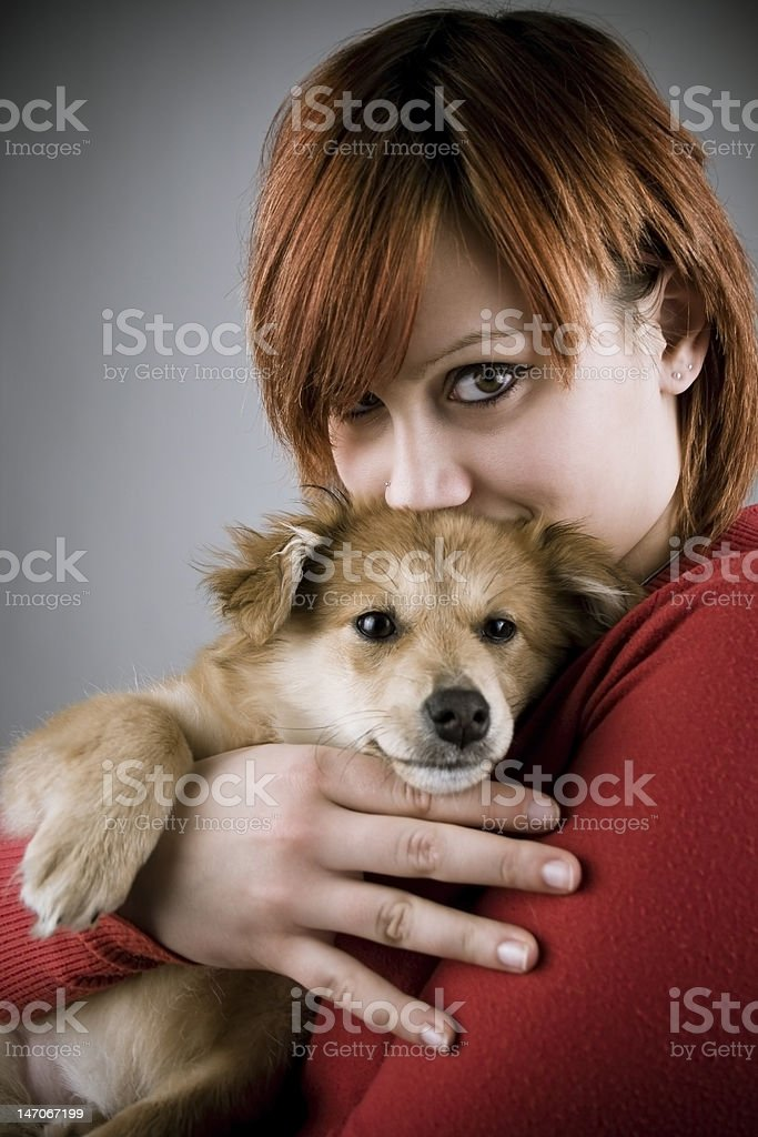 Girl and her puppy royalty-free stock photo