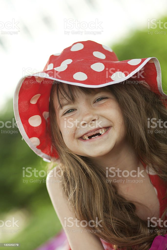 girl and her toothless smile stock photo