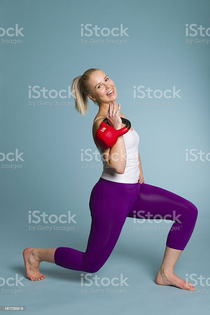Girl and kettlebell royalty-free stock photo