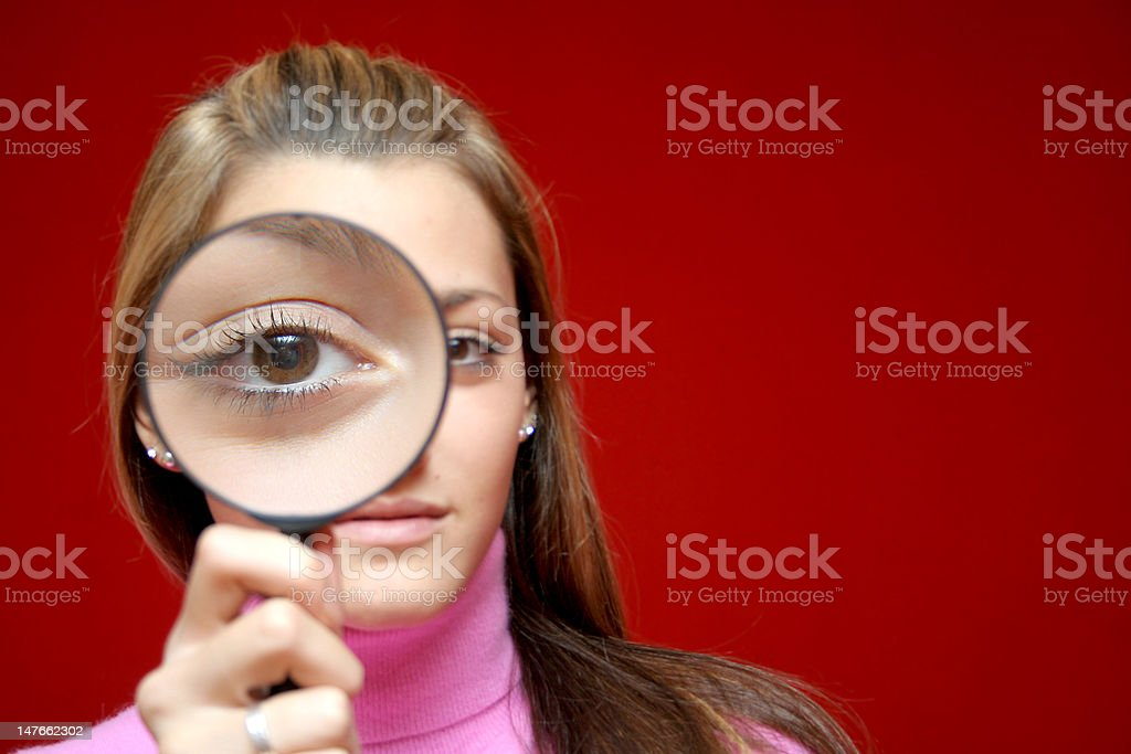 Girl and lens royalty-free stock photo