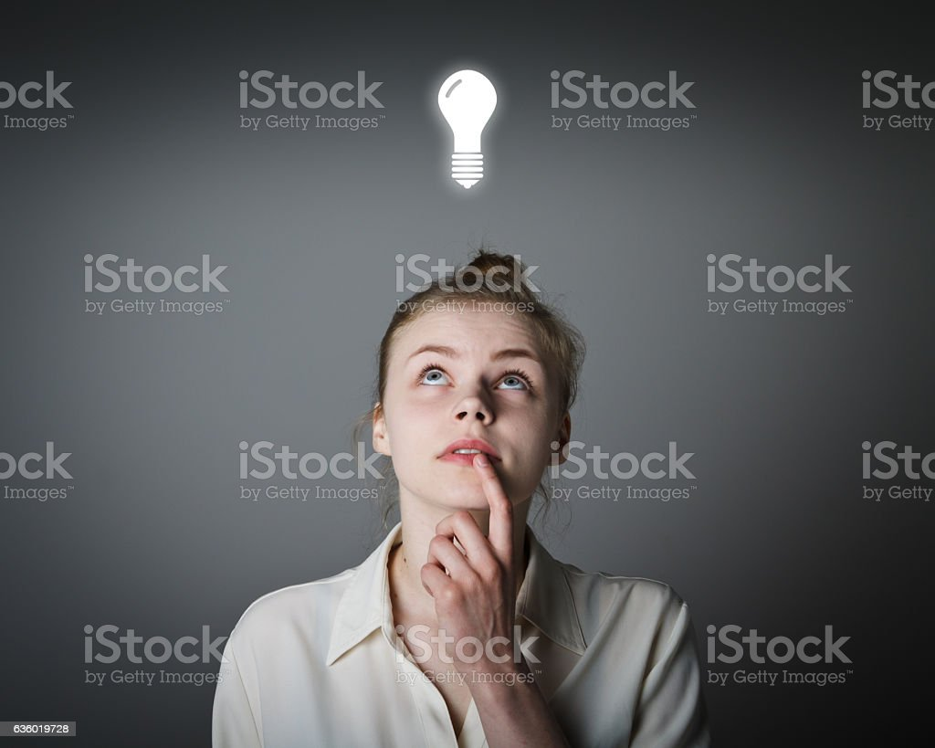 Girl and light bulb stock photo