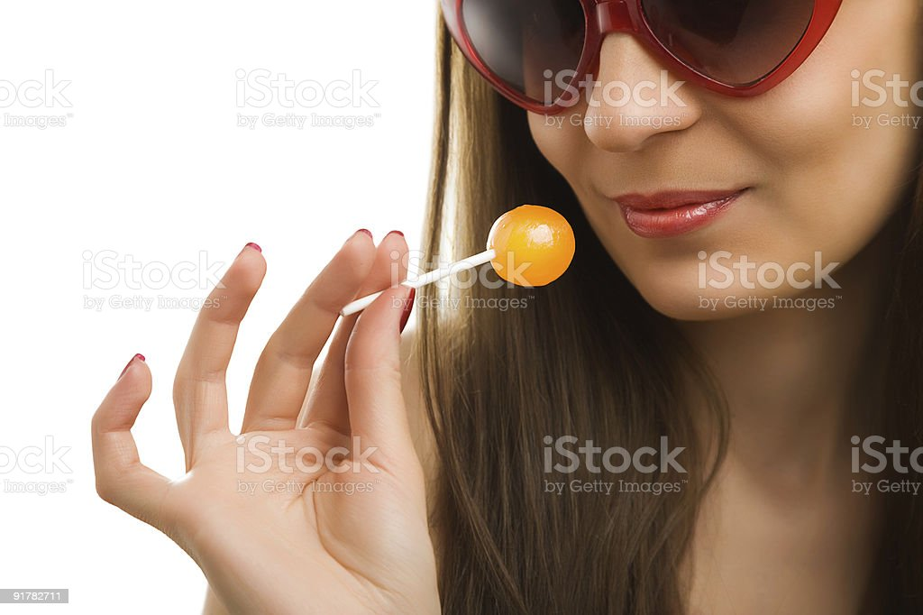 Girl and lollypop royalty-free stock photo