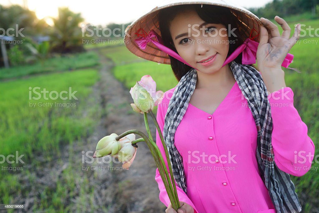 Girl and lotus stock photo
